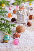stock photo of hazelnut tree  - Walnuts and hazelnuts are on the background of snow and fir branches