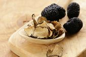 foto of edible mushroom  - expensive rare black truffle mushroom - gourmet vegetable