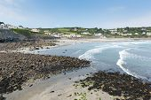 stock photo of west village  - Coverack beach Cornwall England UK with white waves coastal fishing village on the Lizard Heritage coast South West England on a sunny summer day - JPG