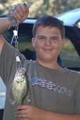 stock photo of crappie  - First catch - JPG