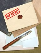 stock photo of wax seal  - military top secret envelope with stamp and knife for papers - JPG