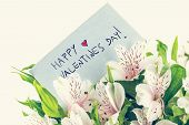 picture of day-lilies  - Vintage style Valentines background with a handwritten note saying  - JPG