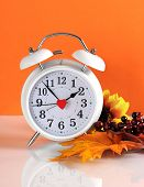 image of daylight-saving  - Daylight savings time ends in autumn fall with clock concept on orange background - JPG