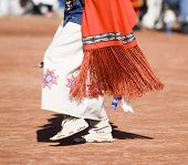 foto of native american ethnicity  - Native American dancers in traditonal rigalia perform during a Pow Wow - JPG