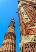 picture of qutub minar  - Famous Qutub Minar complex and decorative pattern of one of its mosque in Delhi - JPG