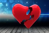 stock photo of shimmer  - Broken heart against shimmering light design over boards - JPG