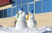 image of snowman  - cute snowmen on the white snow - JPG