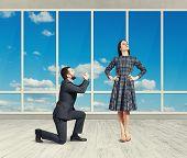 image of forgiveness  - sad man looking at young attractive woman and asking for forgiveness - JPG