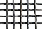 picture of reinforcing  - Bunch of several reinforcement bars isolated on white background - JPG