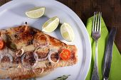 pic of pangasius  - Dish of Pangasius fillet with spices and vegetables on plate and wooden table background - JPG
