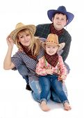 stock photo of baby cowboy  - Happy young family in cowboy clothes - JPG