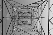 stock photo of electricity pylon  - Black and white below view of an electricity pylon