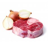 picture of veal meat  - Big slice of meat with onions on a white background - JPG