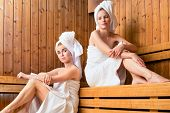 stock photo of sauna  - Two Women in sauna of wellness spa relaxing  - JPG