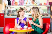 picture of ice cream parlor  - Friends meeting in ice cream parlor or cafe with cappuccino and ice - JPG