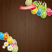 foto of wood craft  - Easter colored eggs on wood background with copy space - JPG