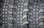 image of four-wheel drive  - Four wheel drive tire stack as a background - JPG