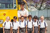 pic of pupils  - Cute pupils with their school bus driver outside the elementary school - JPG
