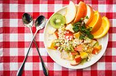 pic of oats  - Oat flakes and fruit salad on wooden table - JPG