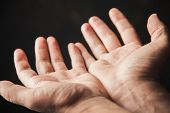 image of begging  - hands begging on a brown background - JPG