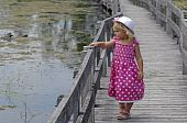 Little blond girl on boardwalk