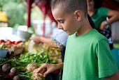 stock photo of farmers market vegetables  - Cute boy with his mother buying fresh vegetables at the farmer - JPG