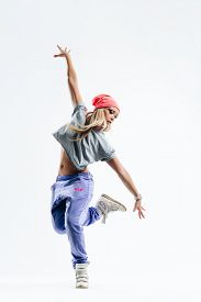 pic of  dancer  - young beautiful dancer jumping on a studio background - JPG