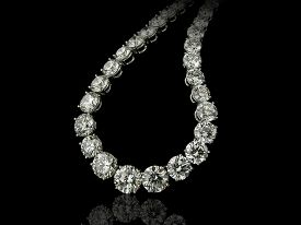 picture of collier  - A close up of a high jewelry collier made by round diamonds on a black background with reflection - JPG