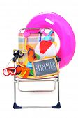 stock photo of beach-ball  - a foldable beach chair full of beach items - JPG