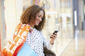 picture of mall  - Woman In Shopping Mall Using Mobile Phone - JPG