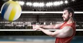 stock photo of volleyball  - Volleyball player on red uniform in volleyball court - JPG