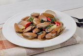 stock photo of clam  - stir fried clams with basil thai food - JPG