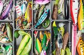 stock photo of spinner  - fishing lures and accessories in the box background - JPG