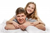 foto of laying-in-bed  - Happy smiling couple laying laughing in bed on white background - JPG