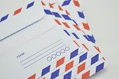 stock photo of contortion  - Stack of air mail envelopes on white background - JPG
