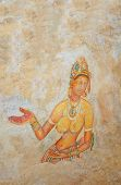 image of cave woman  - 5th Century Sigiriya Rock Cave Wall Paintings. Sigiriya is UNESCO listed World Heritage Site in Sri Lanka