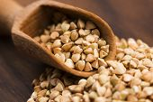 picture of buckwheat  - Buckwheat with a spoon on a wooden boards background - JPG