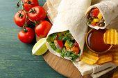 stock photo of potato chips  - Homemade tasty burrito with vegetables - JPG