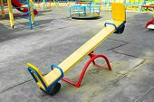 image of seesaw  - Empty seesaw on playground in public park - JPG