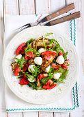 image of rocket salad  - Zucchini mozzarella tomato and rocket salad on plate - JPG