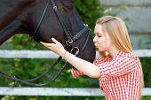 stock photo of horse girl  - Reveling in kissing - JPG