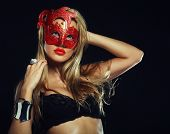 stock photo of stripping women window  - young sexy woman in black lingerie wearing mask - JPG