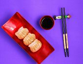 foto of siomai  - Vietnam style steamed shrimp dumplings served on a purple background - JPG