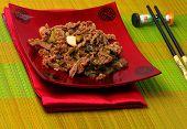 pic of stir fry  - Vietnamese beef stir fry served on a bamboo place mat - JPG
