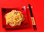 picture of carbonara  - spaghetti carbonara served on a red blackground - JPG