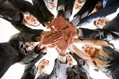 image of business-partner  - business people teamwork in an office with hands together  - JPG