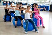foto of pilates  - Group of people in a pilates class at the gym - JPG