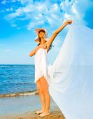 stock photo of nudism  - Beach Wings Relaxation - JPG