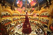 PARIS - DECEMBER 30: The Christmas tree at Galeries Lafayette, trade pavilions with perfume, view fr