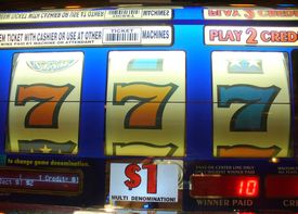 stock photo of slot-machine  - slot machine showing three sevens which means money and winning - JPG